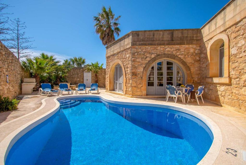 The swimming pool at or near Ta Cenc