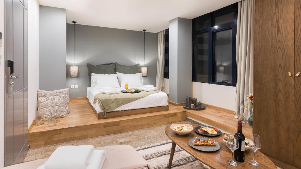 A bed or beds in a room at Ciel Living Athens