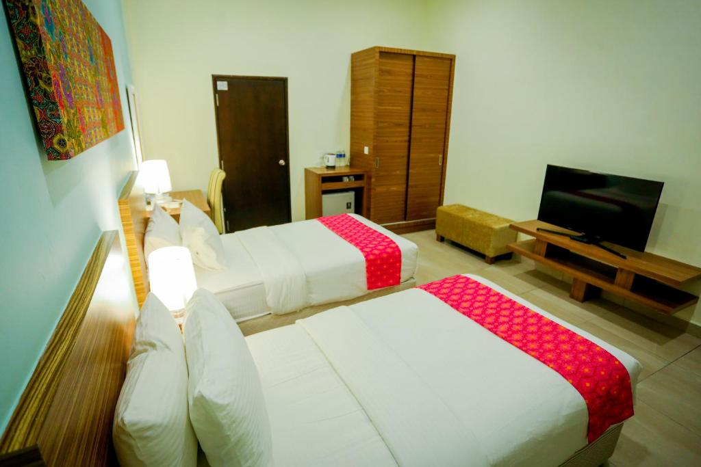 Aava Malacca Hotel 객실 침대