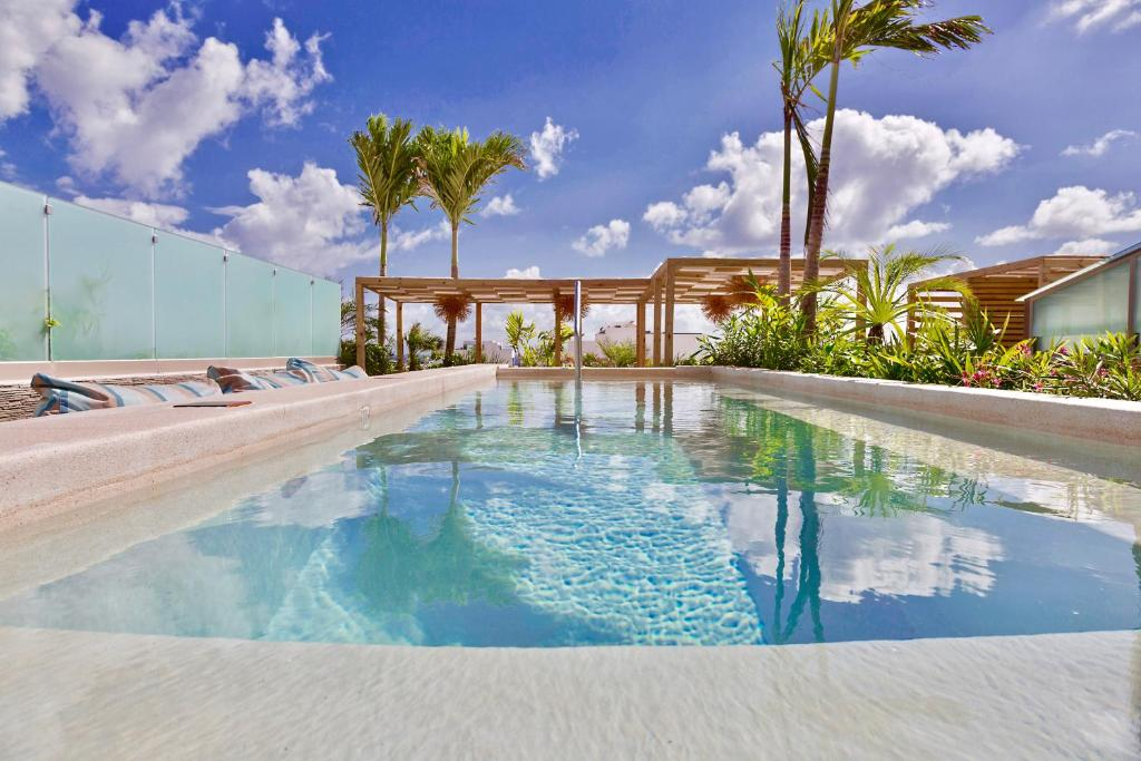 The swimming pool at or close to Newport House Playa Boutique Hotel
