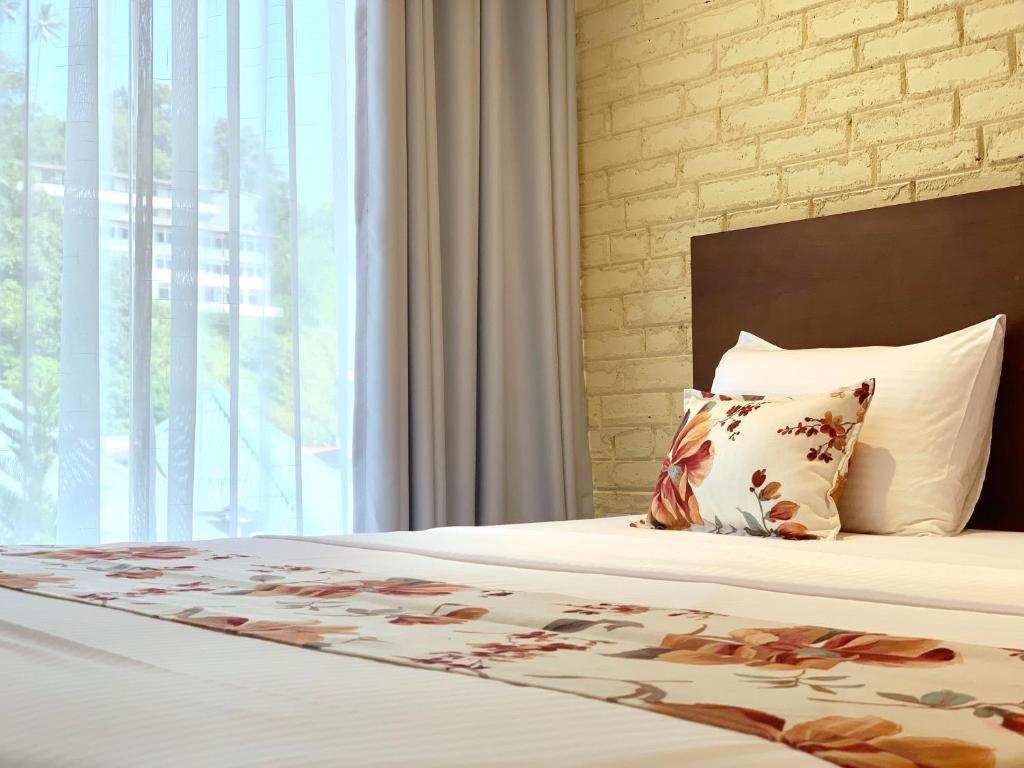Ein Bett oder Betten in einem Zimmer der Unterkunft Sweet Lanka Boutique Kandy