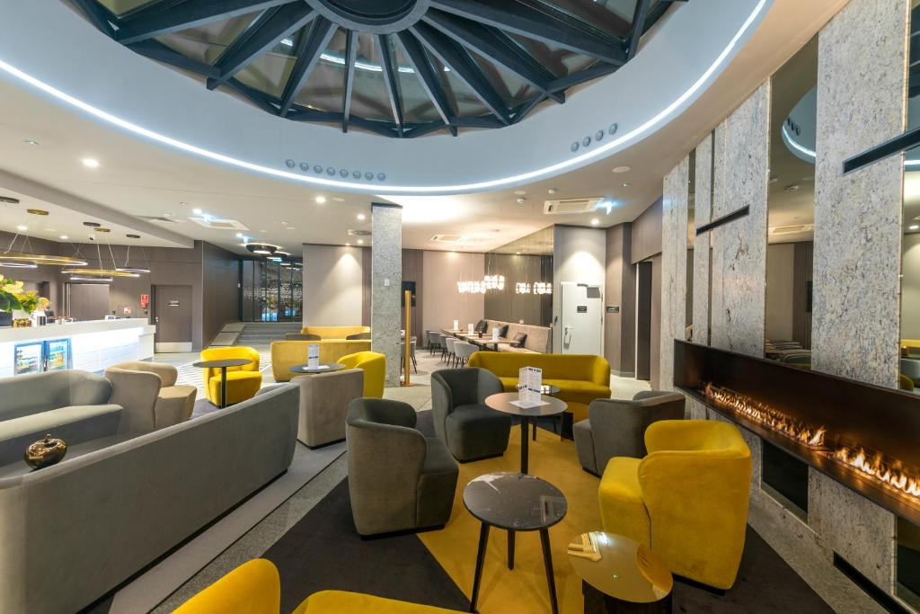 A restaurant or other place to eat at Hampton By Hilton Poznan Old Town
