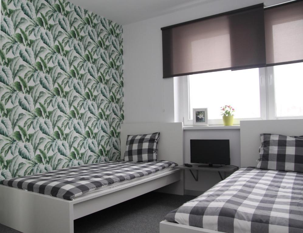 Łóżko lub łóżka w pokoju w obiekcie Helio Hostel