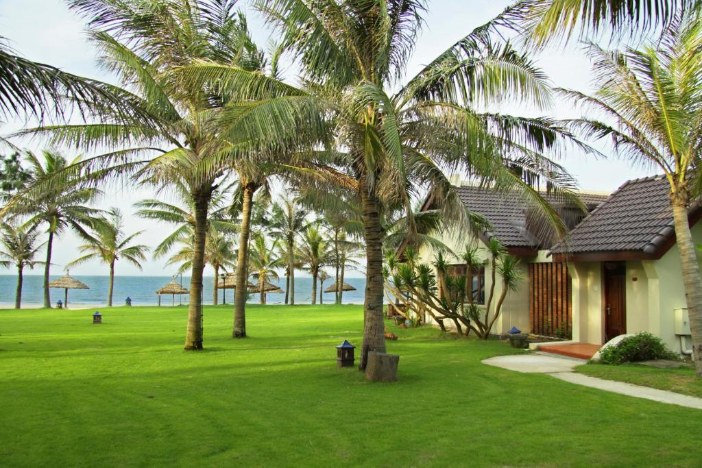 A garden outside Palm Garden Beach Resort & Spa