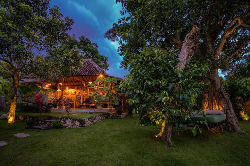 A garden outside The Bali Boarding House