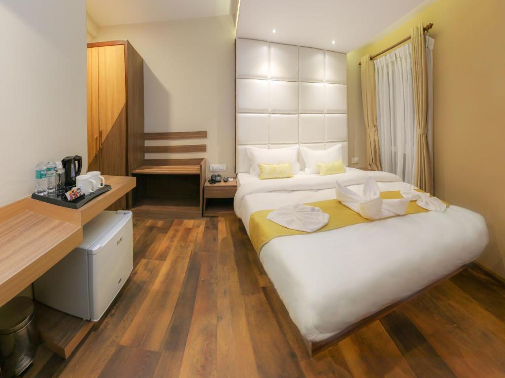 מיטה או מיטות בחדר ב-HOTEL BIHANI