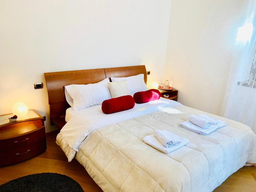 A bed or beds in a room at Casa degli Orti