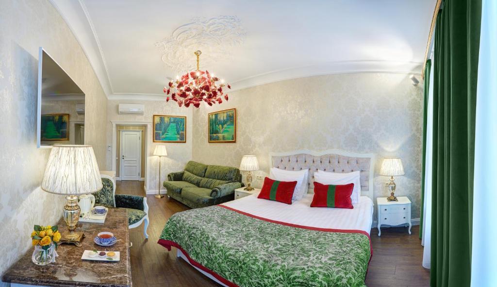 Кровать или кровати в номере Бутик-отель Росси