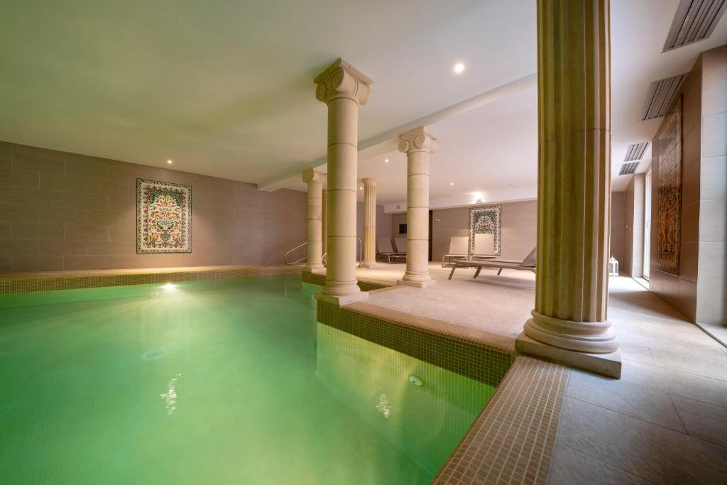The swimming pool at or near Hotel Majestic Alsace - Strasbourg Nord