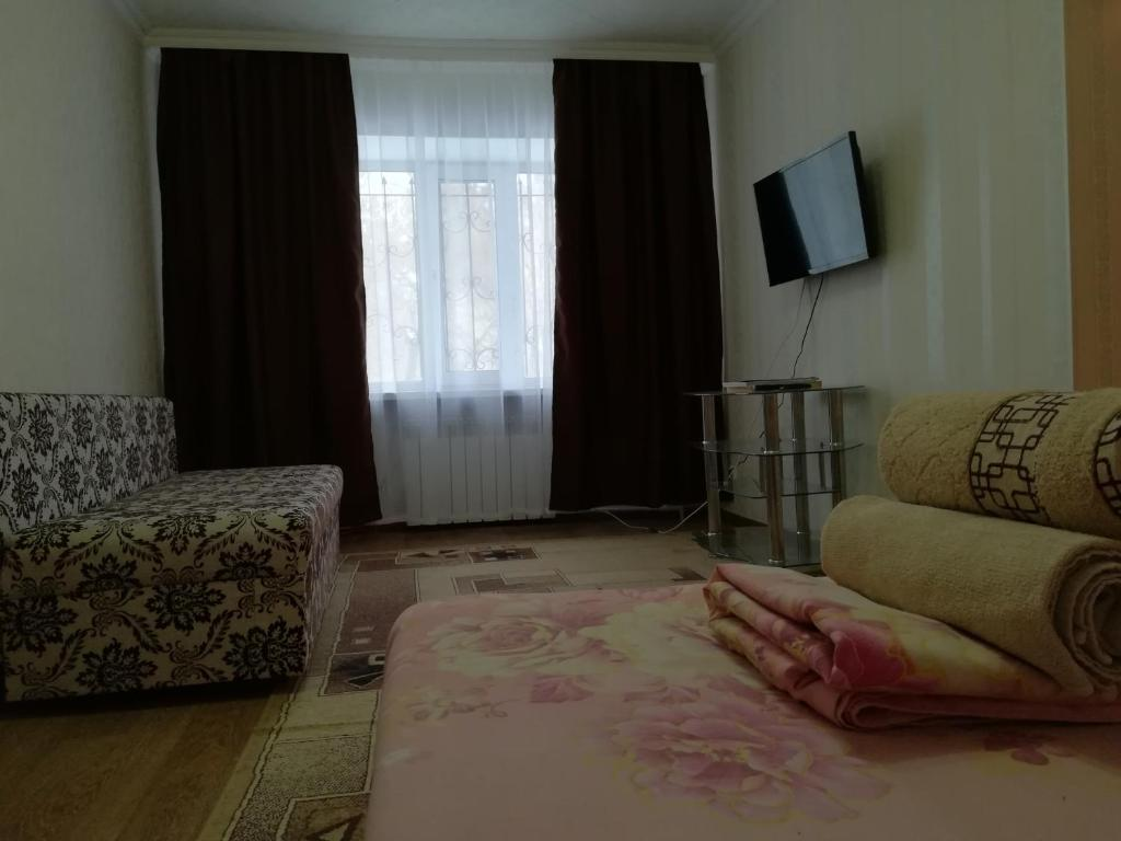 Гостиная зона в Apartment on Bulvar Mira,19a