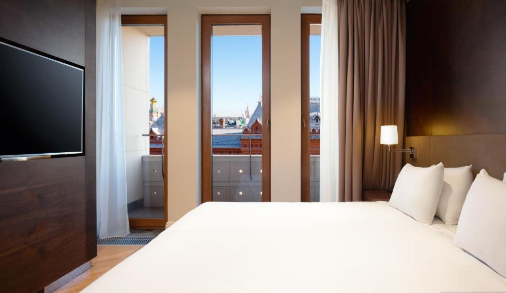 Кровать или кровати в номере Резиденции Москва - Сервисные Апартаменты