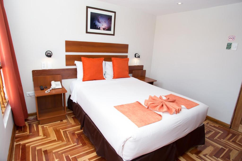 Cama o camas de una habitación en Hotel Arcangel