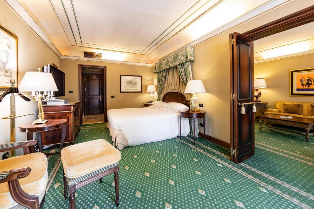 A bed or beds in a room at River Chateau Hotel