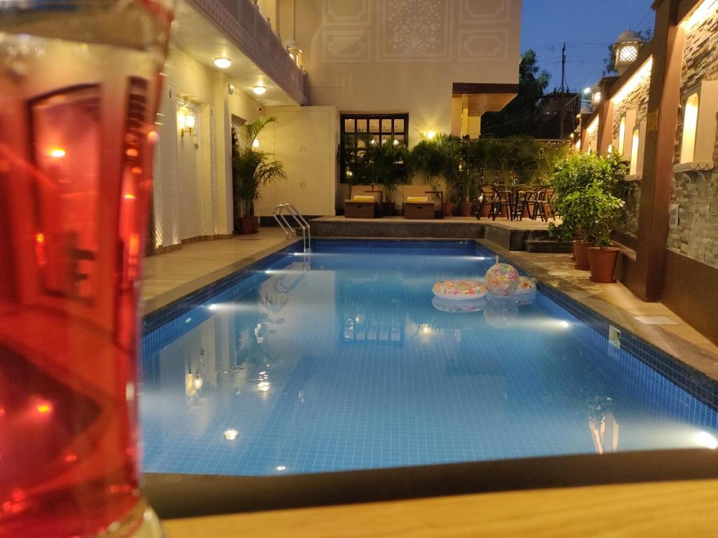 The swimming pool at or near Laxmi Palace Heritage Boutique Hotel