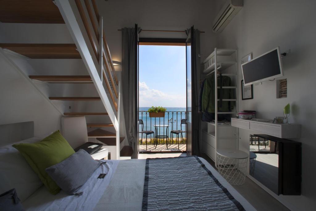 Uma vista do mar tirada do cama e café (B&B)