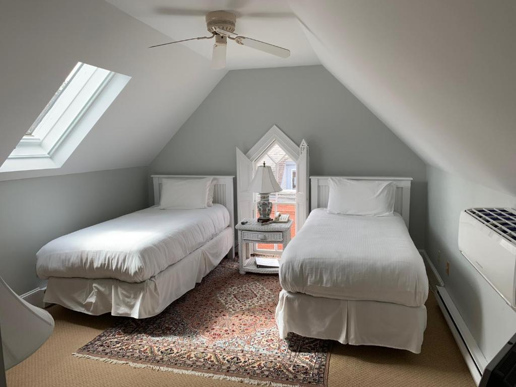 A bed or beds in a room at Belfry Inn and Bistro
