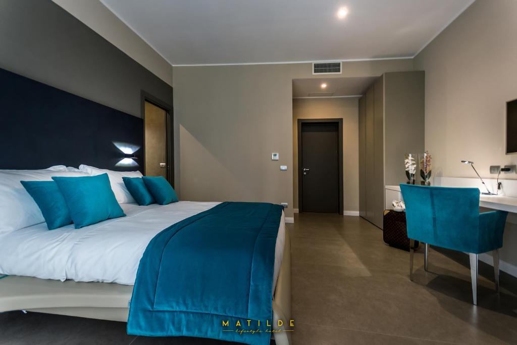 Ein Bett oder Betten in einem Zimmer der Unterkunft Hotel Matilde - Lifestyle Hotel