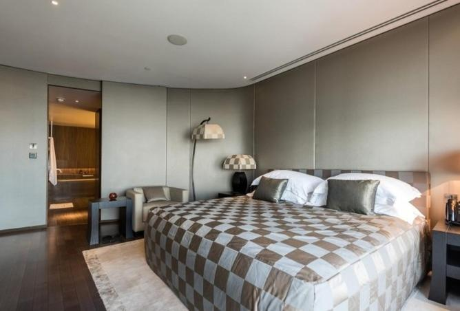 A bed or beds in a room at Sea view downtown Apartment