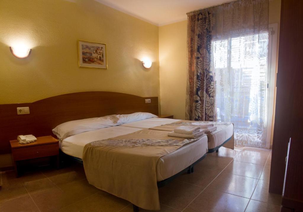 Cama o camas de una habitación en Hotel Sunshine Park