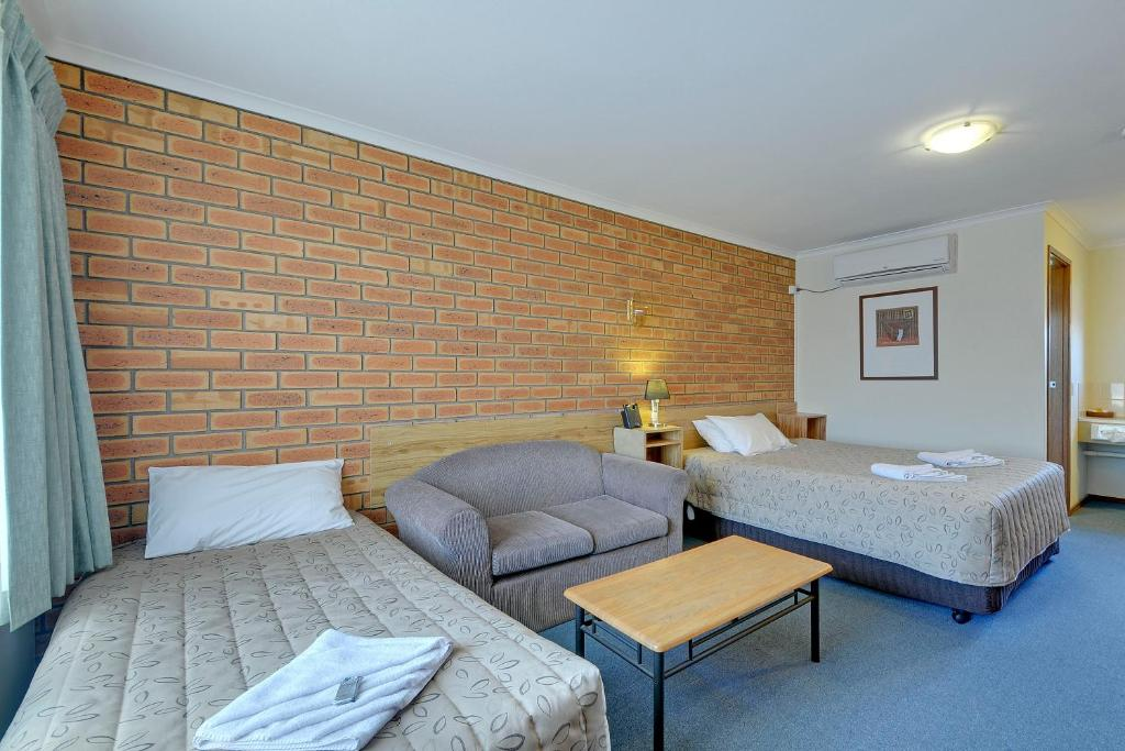 A bed or beds in a room at Always Welcome Motel