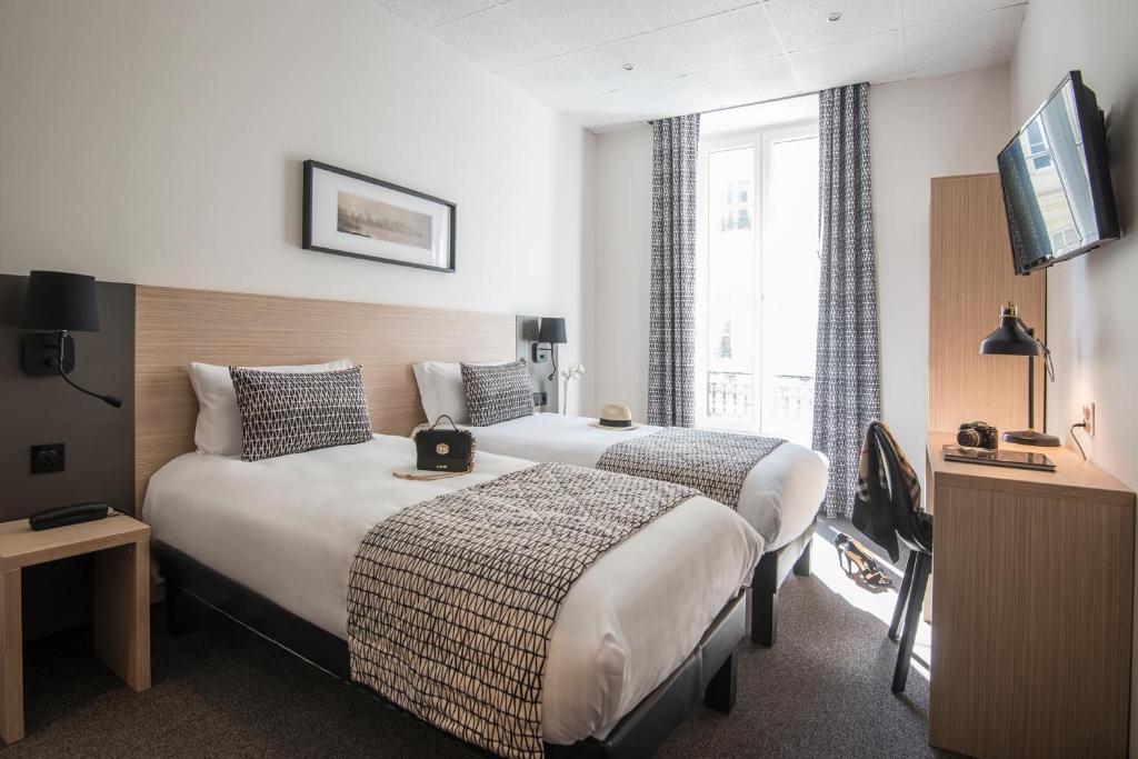 Un ou plusieurs lits dans un hébergement de l'établissement Hotel Saint Gothard