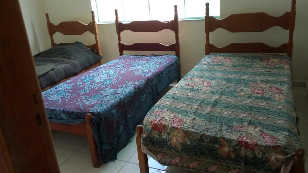 Een bed of bedden in een kamer bij Cabo frio, centro