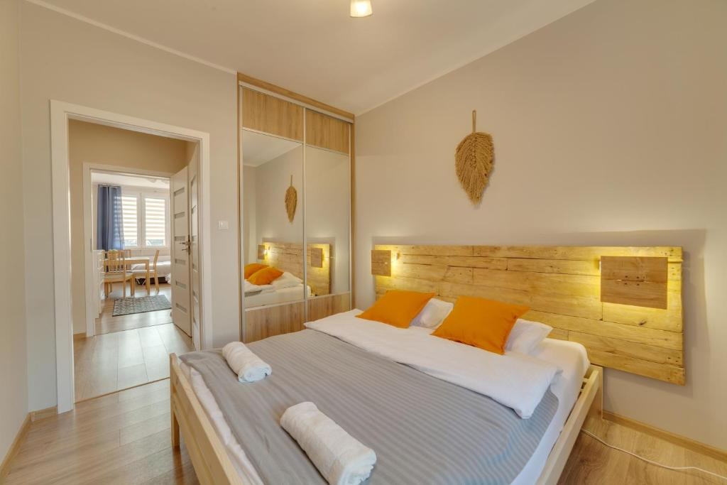 A bed or beds in a room at Dream Loft Krosna