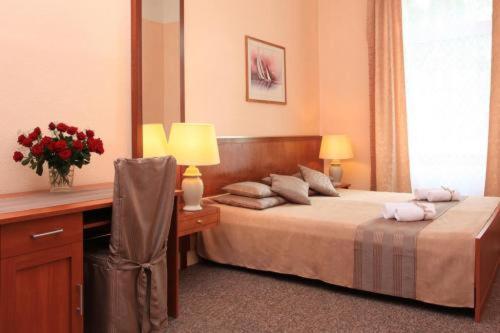 Ein Bett oder Betten in einem Zimmer der Unterkunft Hotel Arche