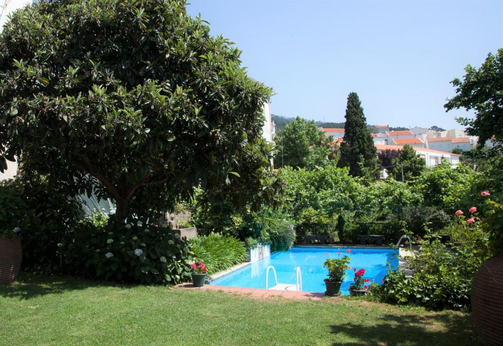 The swimming pool at or near Casa Das Obras