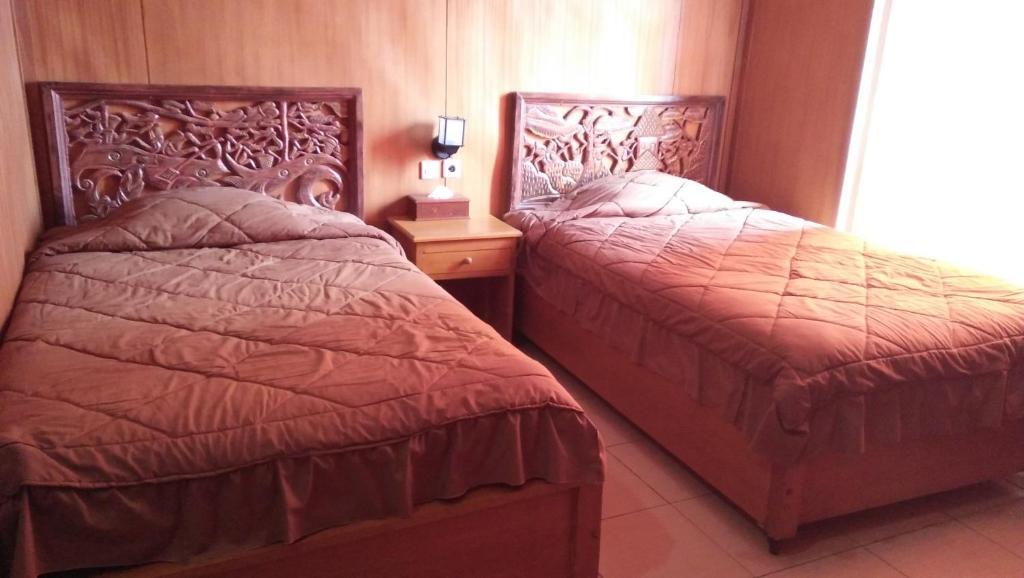 Cama o camas de una habitación en Cafe Lava Hostel