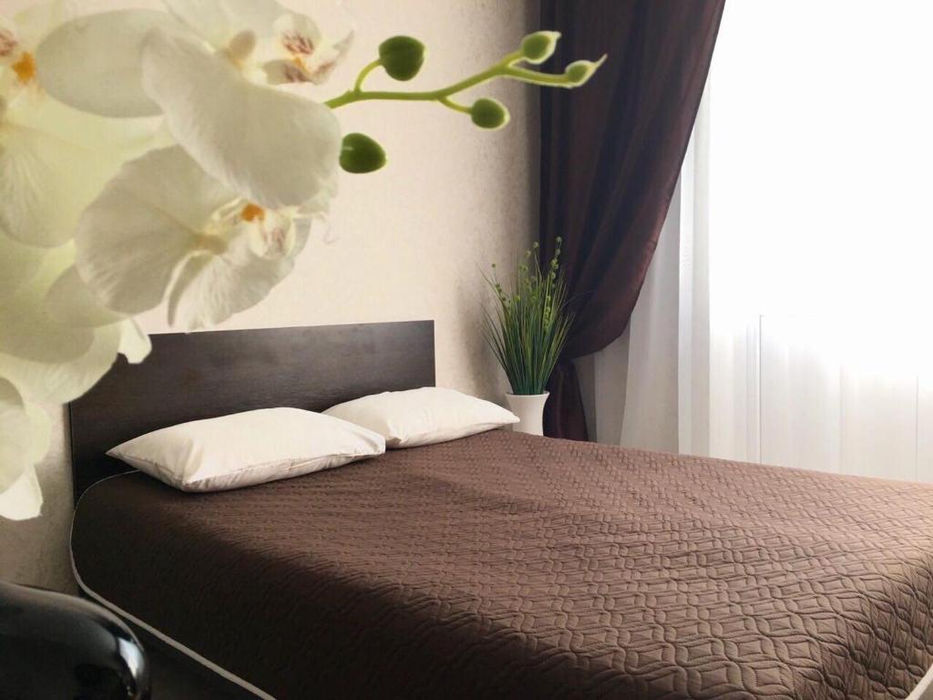 Кровать или кровати в номере Apartment Antonova 5L