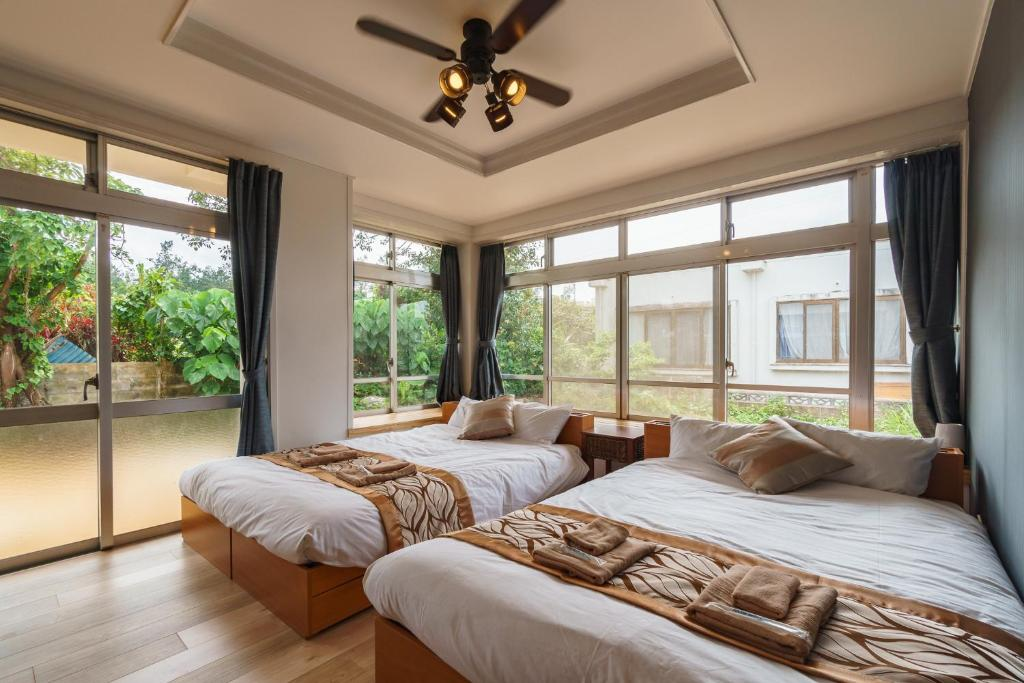 A bed or beds in a room at Ikidane House Onnason Maeda