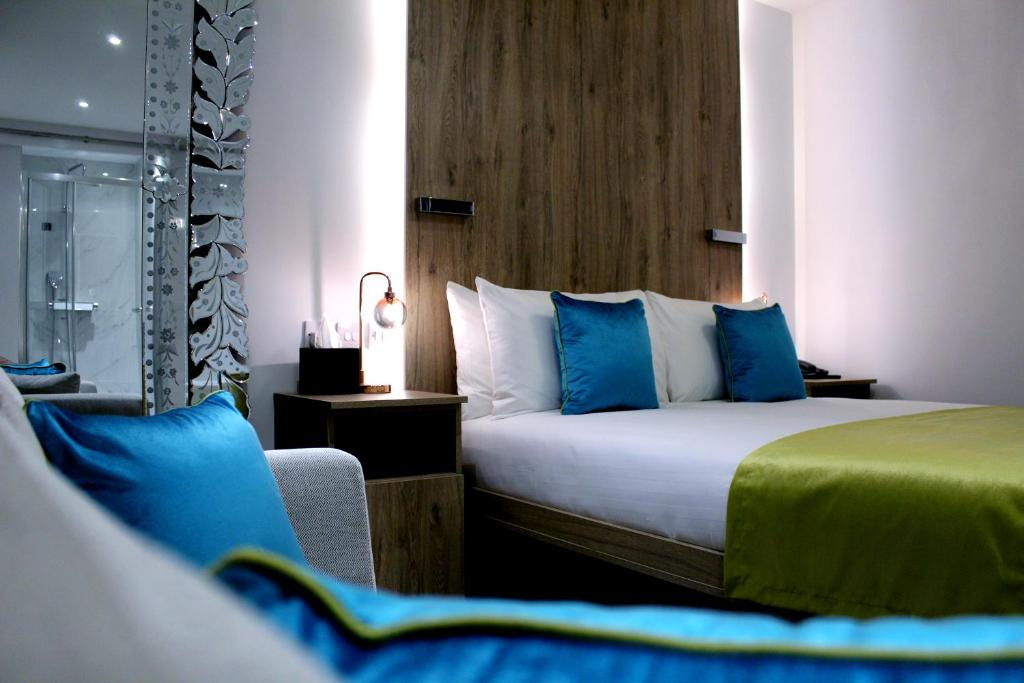 A bed or beds in a room at O Hyde Park
