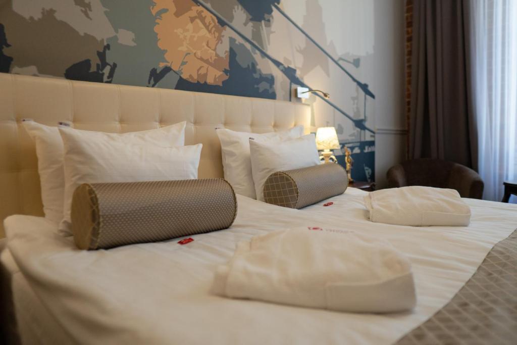 Кровать или кровати в номере Галунов Отель