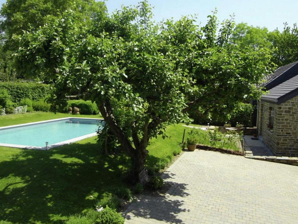 A view of the pool at Holiday home Le Pommier Centenaire or nearby