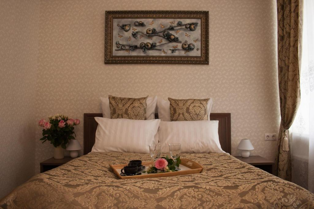 Кровать или кровати в номере Мини-отель У Театра