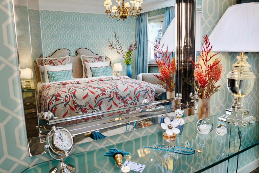 Säng eller sängar i ett rum på Hotel Estheréa