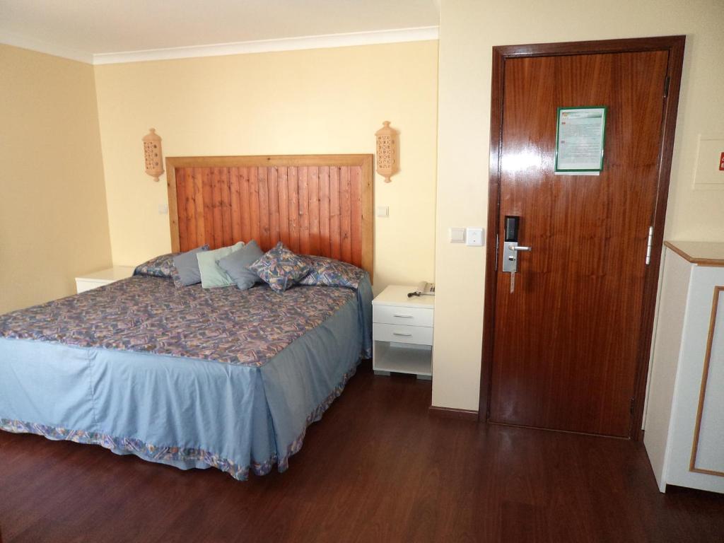 Säng eller sängar i ett rum på Vila Branca