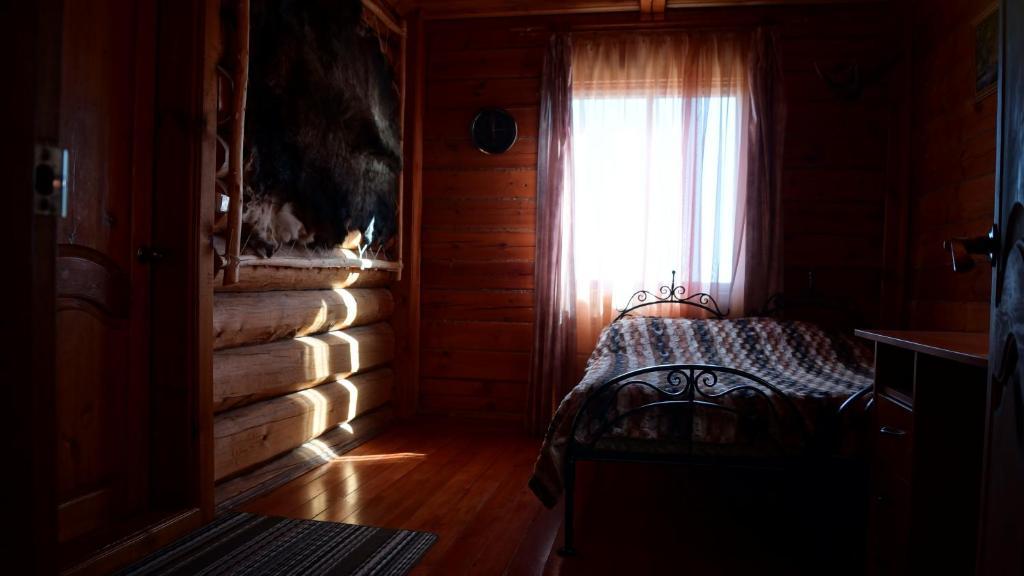 Кровать или кровати в номере Guest House Bolshoe Goloystnoe