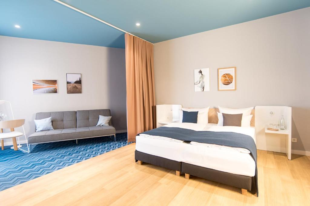 A bed or beds in a room at about:berlin Hotel