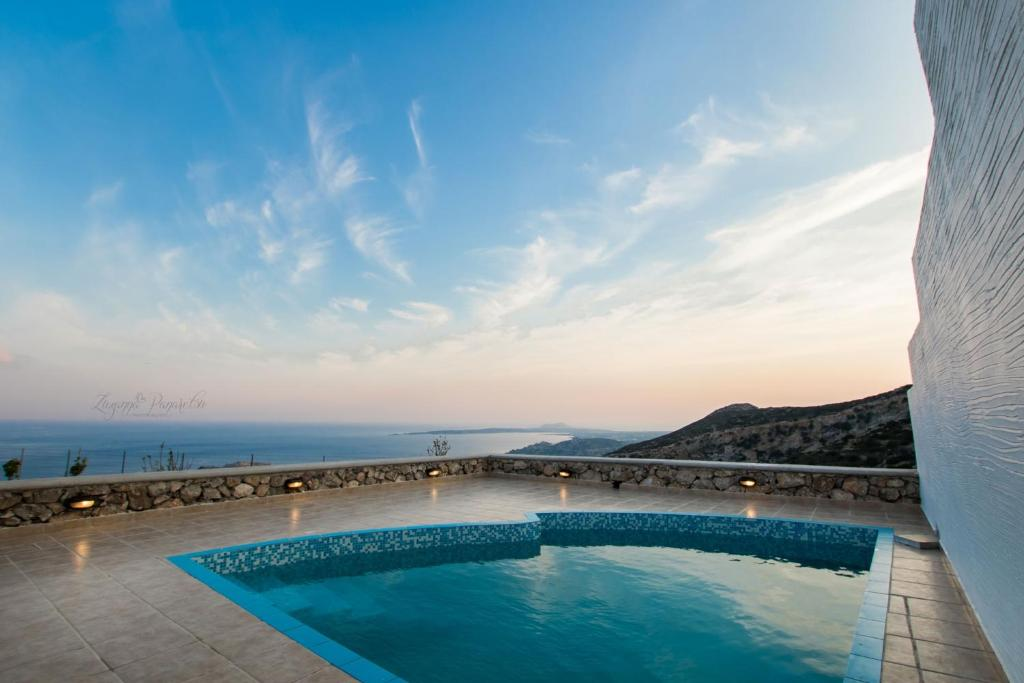 The swimming pool at or near Anemolia Villa