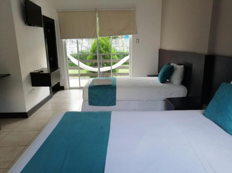 A bed or beds in a room at Ocean Blue