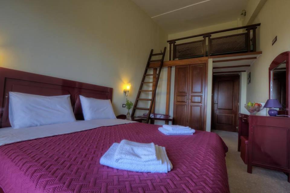 Łóżko lub łóżka w pokoju w obiekcie Αγία Θεοδώρα Αρκαδία