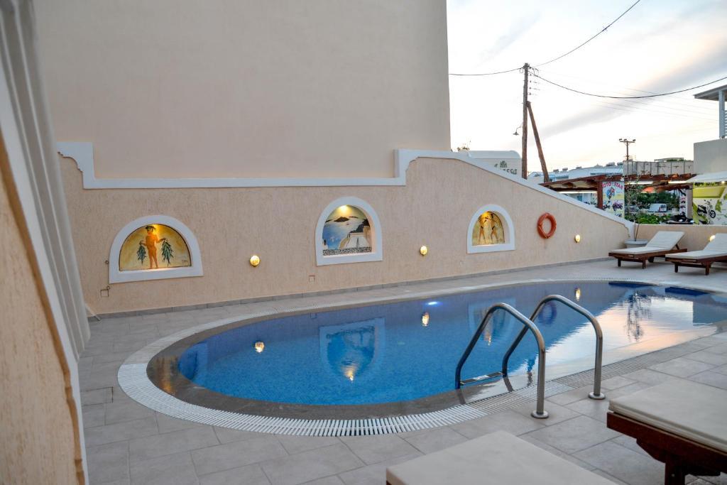 The swimming pool at or near Villa Irini Studios
