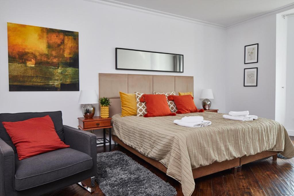 Ein Bett oder Betten in einem Zimmer der Unterkunft Royal Route Residences