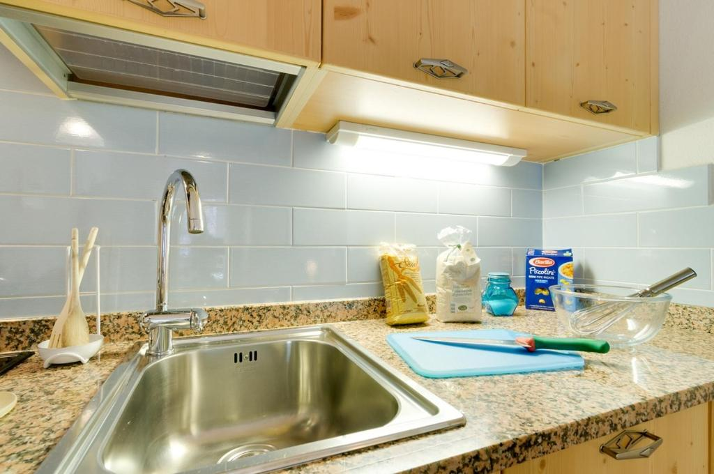A kitchen or kitchenette at Appartamenti Cesa Maria Mountain Hospitality