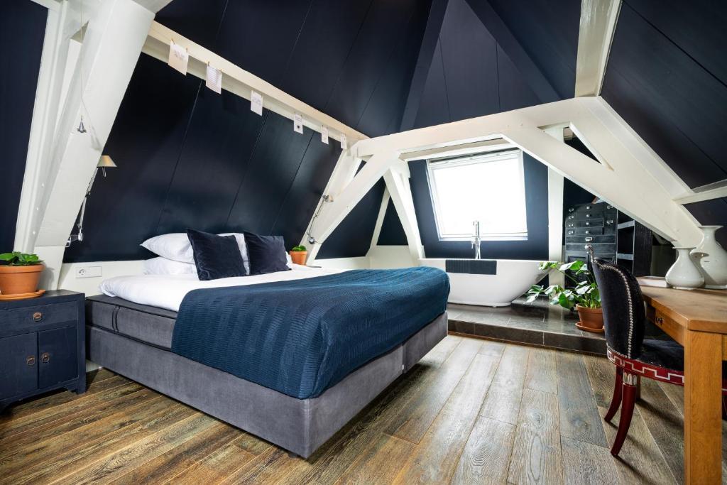 Een bed of bedden in een kamer bij Hotel Simple