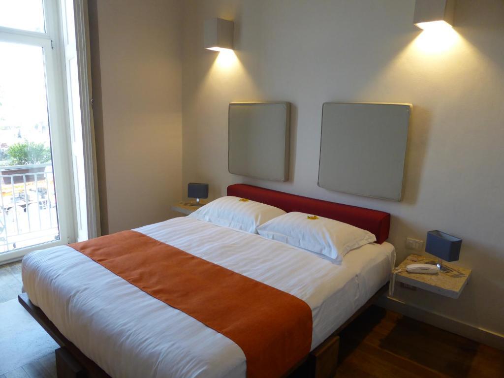 Ein Bett oder Betten in einem Zimmer der Unterkunft Micalò