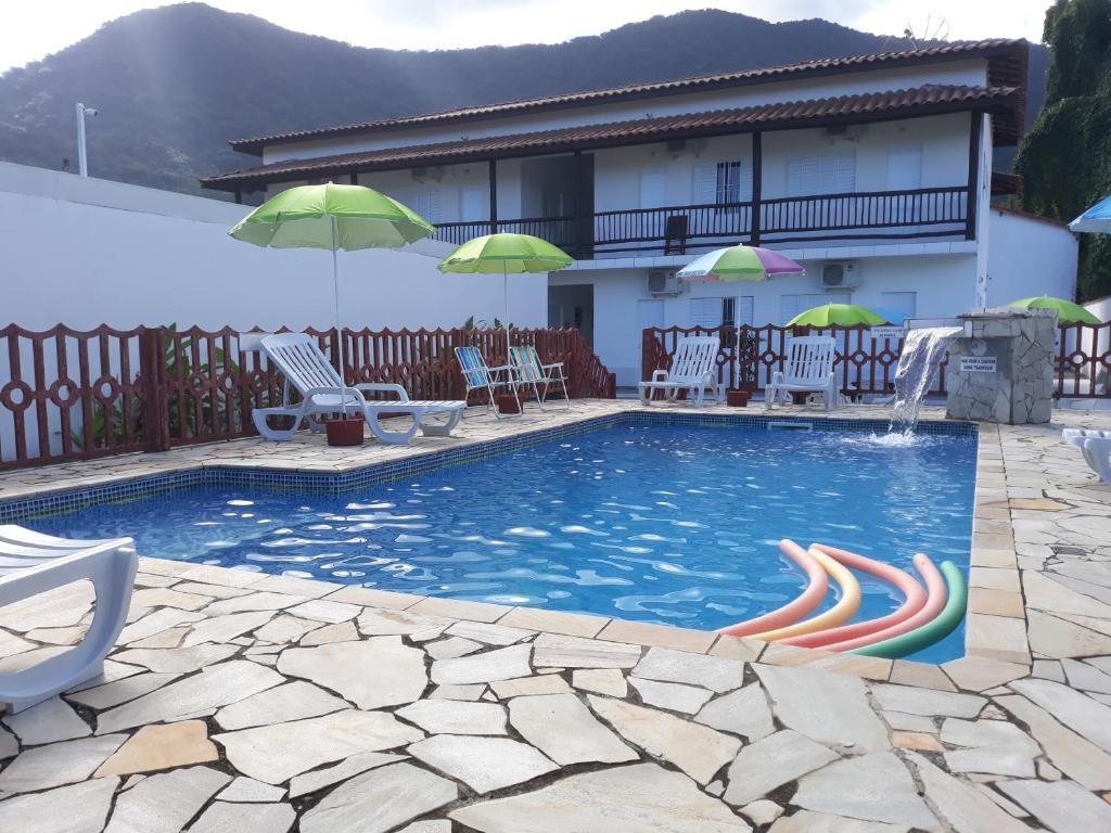 The swimming pool at or near POUSADA TANI COM AR E PISCINA em MARESIAS