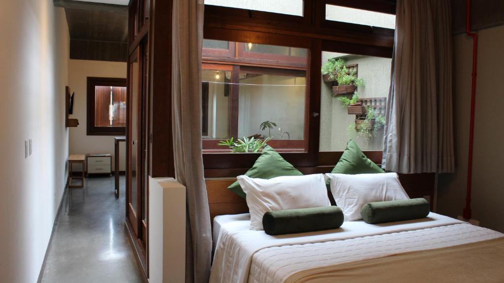 Cama ou camas em um quarto em Pitaya Apart Hotel
